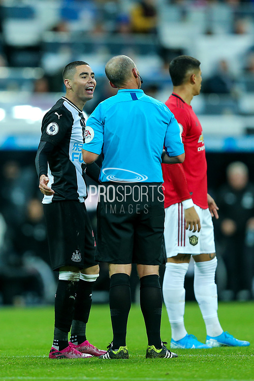 Miguel Almiron (#24) of Newcastle United protests at being shown a yellow card by referee Mike Dean for simulation during the Premier League match between Newcastle United and Manchester United at St. James's Park, Newcastle, England on 6 October 2019.