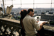 France. Paris elevated view from Notre dame cathedral. tourists watching paris cityscape , from  Notre dame cathedral