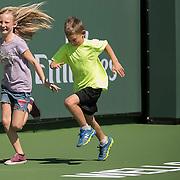 March 7, 2015, Indian Wells, California:<br /> Kids run during Kids Day at the Indian Wells Tennis Garden in Indian Wells, California Saturday, March 7, 2015.<br /> (Photo by Billie Weiss/BNP Paribas Open)
