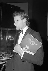 NICHOLAS PHILLIPS (d.1991) of Luton Hoo at a reception in London in September 1987.