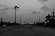 The road to Misrata from Al  Dafniyah frontline : a grim warning to Gadhafi's loyalists hangs atop of a pole.  30 May 2011.