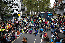 © Licensed to London News Pictures. 07/10/2019. London, UK. Extinction Rebellion activists blockade Marsham Street outside the Home Office in central London. Activists are converging on Westminster blockading roads in the area for at least two weeks calling on government departments to 'Tell the Truth' about what they are doing to tackle the Emergency. Photo credit: Peter Macdiarmid/LNP