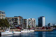 A picture of city buildings and boats by the waterfront in Sydhavnen in Copenhagen.