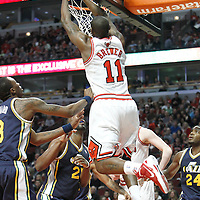 10 March 2012: Chicago Bulls shooting guard Ronnie Brewer (11) dunks the ball during the Chicago Bulls 111-97 victory over the Utah Jazz at the United Center, Chicago, Illinois, USA.