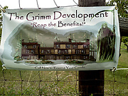 "Cherry orchard banner sign ""The Grimm Development - Reap the Benefits!  Call Now to Reserve Your Condo"""