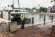 "Annapolis, Maryland - June 05, 2016: Norman Dorsey, public works employee with the City of Annapolis, cleans up detritus left after a perigean spring tide flooded the Kunta Kinte-Alex Haley Memorial park located at the City Dock in historic Annapolis early Sunday morning June 5th, 2016.  <br /> <br /> <br /> A perigean spring tide brings nuisance flooding to Annapolis, Md. These phenomena -- colloquially know as a ""King Tides"" -- happen three to four times a year and create the highest tides for coastal areas, except when storms aren't a factor. Annapolis is extremely susceptible to nuisance flooding anyway, but the amount of nuisance flooding has skyrocketed in the last ten years. Scientists point to climate change for this uptick. <br /> <br /> <br /> CREDIT: Matt Roth for The New York Times<br /> Assignment ID: 30191272A"
