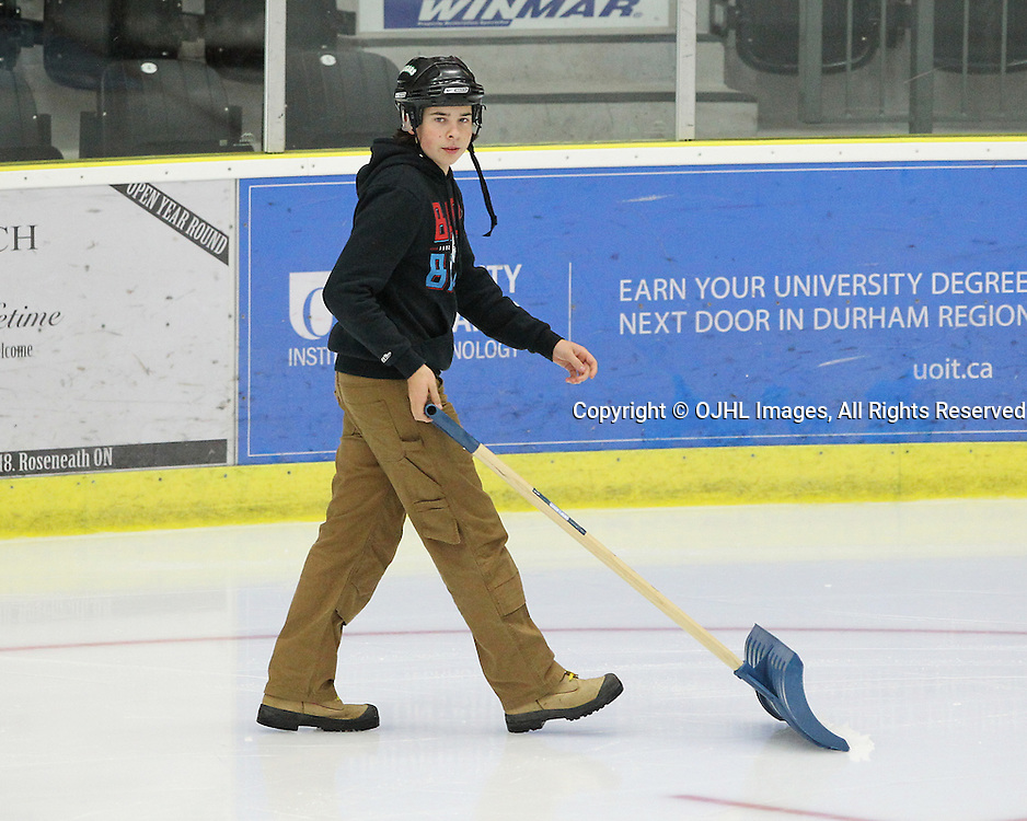 COBOURG, ON  - OCT 3,  2016: Ontario Junior Hockey League game between Newmarket and Cobourg. A member of the Cougars Ice Crew during the second period.<br /> (Photo by Tim Bates / OJHL Images)