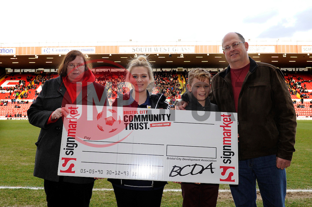 Half time 50/50 winner - Photo mandatory by-line: Dougie Allward/JMP - Tel: Mobile: 07966 386802 01/03/2014 - SPORT - FOOTBALL - Bristol - Ashton Gate - Bristol City v Gillingham - Sky Bet League One