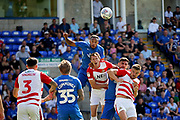 Peterborough United defender Rhys Bennett (16) with an early header during the EFL Sky Bet League 1 match between Peterborough United and Doncaster Rovers at London Road, Peterborough, England on 1 September 2018.
