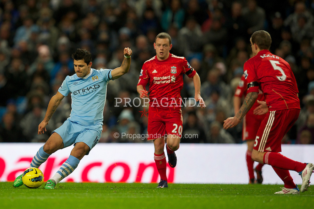 MANCHESTER, ENGLAND - Tuesday, January 3, 2012: Manchester City's Sergio Aguero scores the first goal against Liverpool during the Premiership match at the City of Manchester Stadium. (Pic by David Rawcliffe/Propaganda)