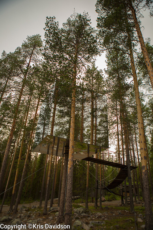 The Mirrorcube at the Treehotel in Harads, Sweden. Treehotel features  treerooms nestled up in the tree branches; with contemporary design in the middle of unspoiled nature, it is a unique experience.