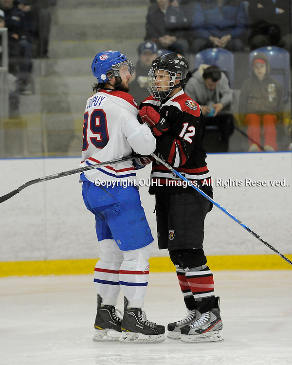 KINGSTON, ON - Apr 4 : Ontario Junior Hockey League, South-West Conference Championship series between Kingston Voyageurs and Newmarket Hurricanes. Brett Du Puy #39 of the Kingston Voyageurs and Elliott Burlon #12 of the Newmarket Hurricanes during third period game action.(Photo by Amy Deroche / OJHL Images)