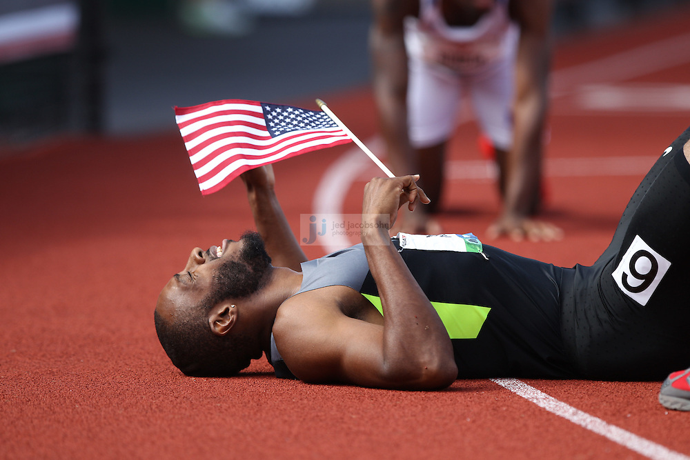 Angelo Taylor lies on the ground after finishing second during the finals of the 400m hurdles during day 10 of the U.S. Olympic Trials for Track & Field at Hayward Field in Eugene, Oregon, USA 1 Jul 2012..(Jed Jacobsohn/for The New York Times)....
