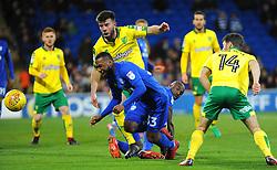 Grant Hanley of Norwich City tackles Junior Hoilett of Cardiff City- Mandatory by-line: Nizaam Jones/JMP - 01/12/2017 -  FOOTBALL - Cardiff City Stadium- Cardiff, Wales-  Cardiff City v Norwich City- Sky Bet Championship