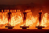 The Man's Army Burn by: Michael Ciulla & The Rave Knights (Alexandra Friedman, Nick Harris, John Jones) with support from Sin Cohen, Steven Platt, Lizzy Layne, Ryan Geist Bozajian & Ciulla Associates from: Los Angeles, CA year: 2019 The Man's Army is 100 androgynous life-sized human figures standing in a 10×10 grid. Each figure has skin of white wax and a unique 3D printed face created by a point-cloud scan of real people. At night an internal LED creates a glow emanating from within. The body and face create a blank canvas for expression. Throughout the week the figures are customized, culminating in a transformative burn. The piece is a visual metaphor contemplating conformity through shared non-conformity. People, from a distance may appear homogeneous but once among them you see their individuality. Through shared experience burners are altered and stretched by the thoughts and intentions of one another and then transformed through an expression of impermanence. URL: http://themansarmy.com Contact: themansarmy@gmail.com