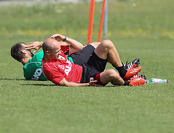 15.07.2013, Walchsee, AUT, FC Augsburg, Trainingslager, im Bild Tobias WERNER (FC Augsburg #13), situps mit Thomas BARTH (Co-Trainer FC Augsburg), // during a trainings session of German 1st Bundesliga club FC Augsburg at their training camp in Walchsee, Austria on 2013/07/15. EXPA Pictures &copy; 2013, PhotoCredit: EXPA/ Eibner/ Klaus Rainer Krieger<br /> <br /> ***** ATTENTION - OUT OF GER *****