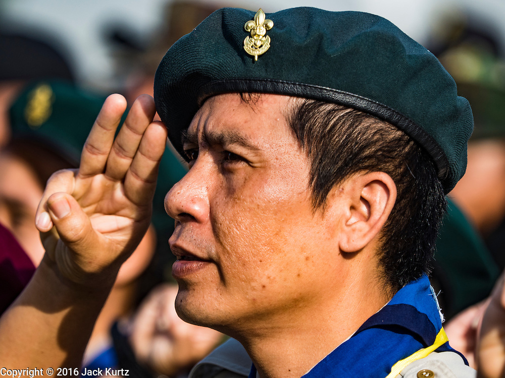 22 NOVEMBER 2016 - BANGKOK, THAILAND:  A Thai Boy Scout leader salutes during a ceremony on Sanam Luang to honor Bhumibol Adulyadej, the Late King of Thailand. Hundreds of thousands of Thais gathered across Thailand Tuesday to swear allegiance to the Chakri Dynasty, in a ceremony called Ruam Phalang Haeng Kwam Phakdi (the United Force of Allegiance). At Sanam Luang, the Royal Parade Ground, and location of most of the mourning ceremonies for the late King, people paused to honor His Majesty by singing the Thai national anthem and the royal anthem.      PHOTO BY JACK KURTZ