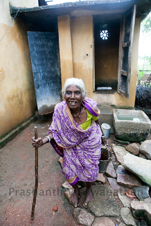 "Village Rajghad, Mul Block, Dist. Chandrapur. .75 year old Jaibai Kalsar proudly stands outside the toilet in her home, in Rajghad.  She said, ""There is more privacy, and she feels more secure in her old age with the toilet being at home."" The entire village is open defecation free, and is considered as an ideal example under the WASH Bio village project.  Bio Village is a part of the over all obejective of the Water Hygiene and Sanitation project ( WASH). UNICEF partners with the State nodal Department, Water Supply and Sanitation Department under the State Government and District level TSC, Divisions, Key resource Centres and NGOs. Special initiatives have been undertaken in the State such as Bio-Village Project in IDPs, WASH Compliance in Schools, Multiple Use Water Services project (MWUS), Sanitary Napkin production and promotion of menstrual hygiene, Risk based rapid assessment of water quality as per JMP manual and NGP concurrent monitoring.UNICEF India/2012/Vishwanathan"