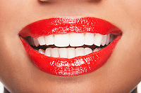 Woman's teeth and mouth with red lipstick