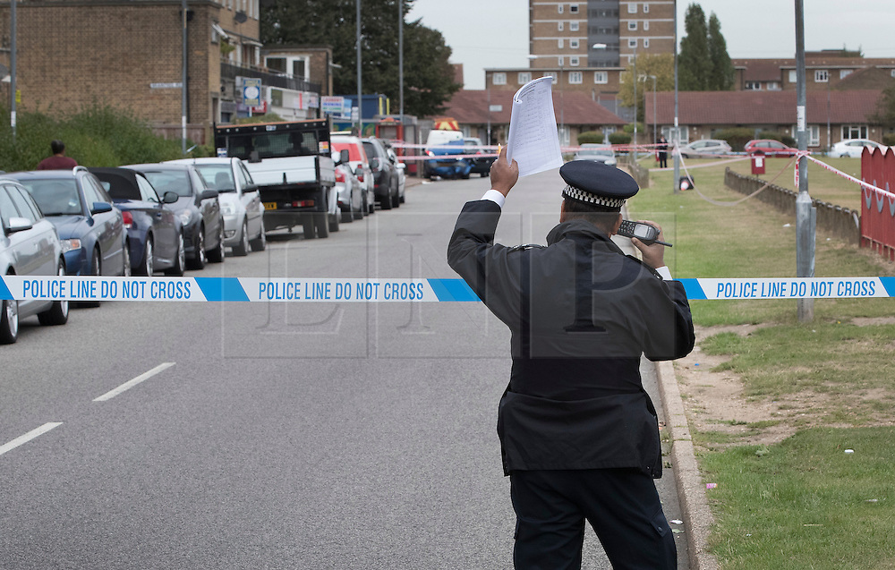 © Licensed to London News Pictures. 26/09/2016. London, UK.  Police man a cordon near Briantree Road, Dagenham after a man was fatally stabbed. Police were called to to a disturbance in Braintree Road on Sunday evening 25th September 2016 where officers found a man in his thirties suffering from stab wounds. He died at the scene a short while later. A murder investigation has been launched. Photo credit: Peter Macdiarmid/LNP