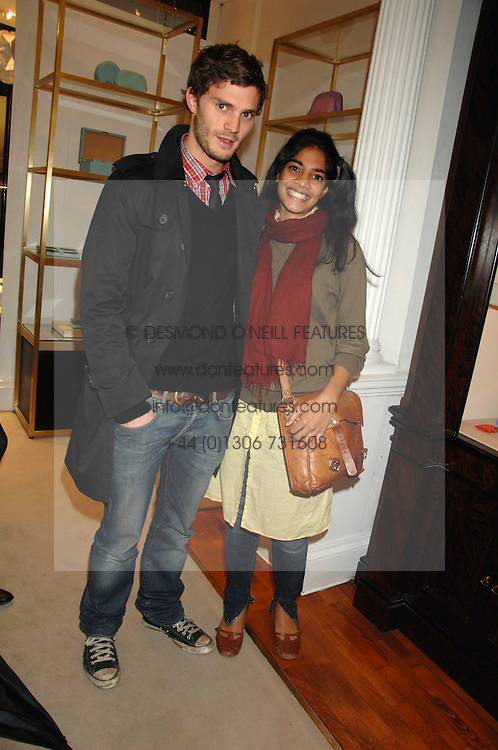 Actor JAMIE DORNAN and actress AMARA KARAN at a party to celebrate the launch of the book 'Long Way Down' by Ewan McGregor and Charley Boorman held at Smythson, 40 New Bond Street, London W1 on 19th November 2007,<br /><br />NON EXCLUSIVE - WORLD RIGHTS