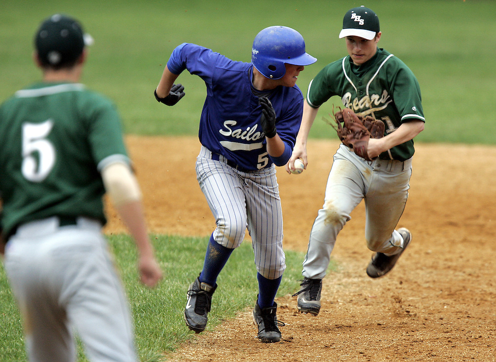 Brewster's Ryan Winch, right, chases Hen Hud's Zack Tepper back to first base after Tepper got caught in a run-down between bases during a boys varsity baseball game between Brewster and Hen Hud at Sunset Park in Montrose May 14, 2009.  Brewster won the game 8-7.   ( Mike Roy / The Journal News )
