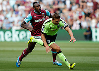 Football - 2016 / 2017 Premier League - West Ham United vs. AFC Bournemouth<br /> <br /> Michail Antonio of West Ham tries to force his way through Bournemouth's Steve Cook at The London Stadium.<br /> <br /> COLORSPORT/DANIEL BEARHAM