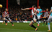 Brentford defender Jack O'Connell gets a powerful header goalwards during the warm up before the Sky Bet Championship match between Brentford and Derby County at Griffin Park, London, England on 20 February 2016. Photo by Andy Walter.
