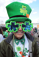 FAIRLESS HILLS, PA -  MARCH 15: Dan Mcauliffe of Langhorne, Pennsylvania wears a green hat and shamrock sunglasses during the St. Patrick's Day Parade March 15, 2014 in Fairless Hills, Pennsylvania.  (Photo by William Thomas Cain/Cain Images)