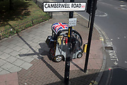 A disabled person drives her mobility scooter on the pavement on the Camberwell Road in Southwark, on 11th June 2019, in south London, England.