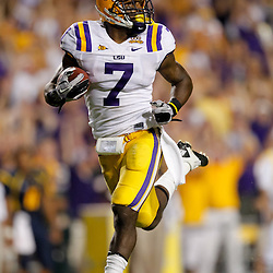 Sep 25, 2010; Baton Rouge, LA, USA; LSU Tigers returner Patrick Peterson (7)returns a punt for a touchdown during the first half against the West Virginia Mountaineers at Tiger Stadium.  Mandatory Credit: Derick E. Hingle