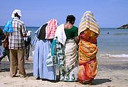 family at the beach, kerala, india