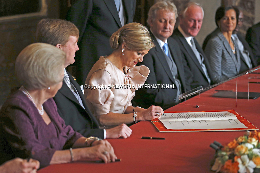 "30.04.2013; Amsterdam : QUEEN BEATRIX OF NETHERLANDS ABDICATES.Queen Maxima signs the Act of Abdication in the Mozeszaal or Mozes Hall of the Royal Palace in Amsterdam, The Netherlands.Mandatory Credit Photos: ©Lampen/NEWSPIX INTERNATIONAL..**ALL FEES PAYABLE TO: ""NEWSPIX INTERNATIONAL""**..PHOTO CREDIT MANDATORY!!: NEWSPIX INTERNATIONAL(Failure to credit will incur a surcharge of 100% of reproduction fees)..IMMEDIATE CONFIRMATION OF USAGE REQUIRED:.Newspix International, 31 Chinnery Hill, Bishop's Stortford, ENGLAND CM23 3PS.Tel:+441279 324672  ; Fax: +441279656877.Mobile:  0777568 1153.e-mail: info@newspixinternational.co.uk"