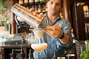 Bode Craig bartends at Percy's in the Ballard Neighborhood of Seattle. Here he mixes up a Sanka Sour which includes egg whites, bitters, and