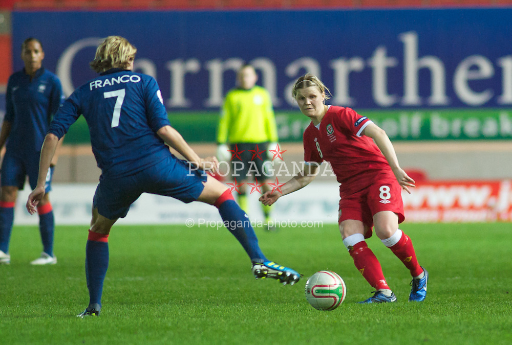 LLANELLI, WALES - Saturday, October 22, 2011: Wales' Michelle Green slides the ball past France's Corine Franco during the UEFA Women's EURO 2013 Qualifying Group 4 at Parc Y Scarlets. (Pic by Gareth Davies/Propaganda)