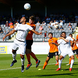 Dovers defender Kevin Lokko leaps for the ball during the National League match between Dover Athletic and Barnet FC at Crabble Stadium, Kent on 1 September 2018. Photo by Matt Bristow.