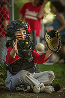 Six year old Tommy Garrett of the Saint Helena Volcanoes catches against the Calistoga Cheetahs at Calistoga Elementary School.