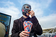 UNITED KINGDOM, London: 25 May 2018  A cosplay fan takes a break with some chips outside of the MCM London Comic-Con this afternoon. The three day comic convention, which is held at London's ExCeL, will see thousands of visitors many of them in cosplay, dressed as their favourite super hero, villain or comic book character. Rick Findler  / Story Picture Agency