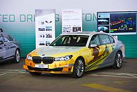 DEU, Deutschland, Germany, Berlin, 10.07.2018: Präsentation zum autonomen Fahren im Flughafen Tempelhof. Ein E-Auto von BMW mit dem Aufdruck der Entwicklungsplattform Apollo. Mit Apollo will Baidu das führende Betriebssystem für das autonome Auto liefern.