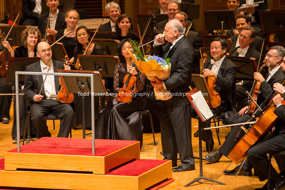 1/28/13 10:05:33 PM  Maestro Lorin Maazel smells a flower from the bouquet given to him following the Chicago Symphony Orchestra's 1st Concert in Hong Kong.  2013 Asia Tour... © Todd Rosenberg Photography 2013