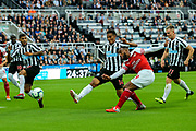 Alexandre Lacazette (#9) of Arsenal fires a shot into the side netting during the Premier League match between Newcastle United and Arsenal at St. James's Park, Newcastle, England on 15 September 2018.