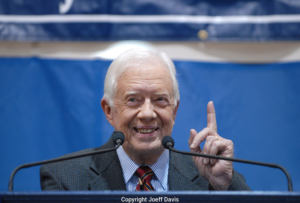 ATLANTA, GA - SEPT 16, 2009: Former president Jimmy Carter visited Emory for his 28th annual Carter Town Hall meeting for Emory University's 1,300 freshmen, in which Carter responds to students questions. This year's event took place against a backdrop of Carter's comment the previous day, quoted by Fox News, that Congressman Joe Wilson's outburst during President Obama's recent speech to Congress was &quot;based on racism.&quot;<br /> <br /> The questions at the Emory event said as much about Carter as it did about the students, many of whom spent the Q&amp;A period texting on their cell phones. The opening question of the evening was what he thought of Kanye West's outburst at the VMA Music awards. Carter responded that he thought it was uncalled for.<br /> <br /> Midway through the hour-long session, he took a question about Obama and racism and responded, &quot;When a radical fringe element of demonstrators and others begin to attack the president of the United States as an animal or as a reincarnation of Adolf Hitler, or when they wave signs in the air that say that we should have buried Obama with Kennedy, those kind of attacks are beyond the bounds of the way presidents have ever been accepted, even with people who disagree [with them]. I think people who are guilty of that type of personal attack against Obama have been influenced to a major degree by a belief that he should not be president because he is African-American. It's a racist attitude.&quot;<br /> <br /> The final question addressed how he upheld his obligations to  his family when he was president. &quot;My family took care of me,&quot; he responded, and with that he left the stage and immediately went to Rosalynn Carter, his wife of 57 years, took her hand and exited.