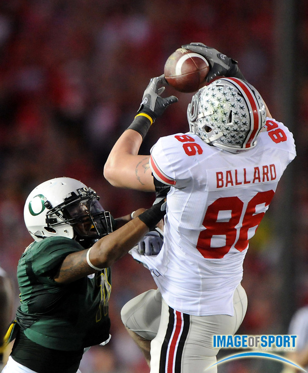 Jan 1, 2010; Pasadena, CA, USA; Ohio State Buckeyes tight end Jake Ballard (86) is defended by Oregon Ducks linebacker Eddie Pleasant (11) on a 24-yard reception in the fourth quarter of the 2010 Rose Bowl at the Rose Bowl. Ohio State defeated Oregon 26-17.