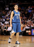 Mar. 12, 2012; Phoenix, AZ, USA;  Minnesota Timberwolves guard Luke Ridnour (13) reacts on the court while playing against the Phoenix Suns at the US Airways Center. The Timberwolves defeated the Suns 127-124.  Mandatory Credit: Jennifer Stewart-US PRESSWIRE.