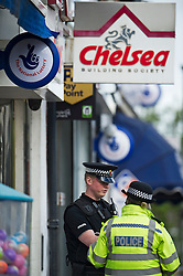 "© London News Pictures. 07/05/2013. Sunbury-On-Thames, UK. Police outside Chelsea Building Society in Sunbury-on-Thames, in Surrey, which was robbed earlier today (Wed). 55-year-old escaped prisoner Michael Wheatley AKA ""Skull Cracker"", who was arrested in east London, is alleged to have carried out the robbery. Photo credit: Ben Cawthra/LNP"