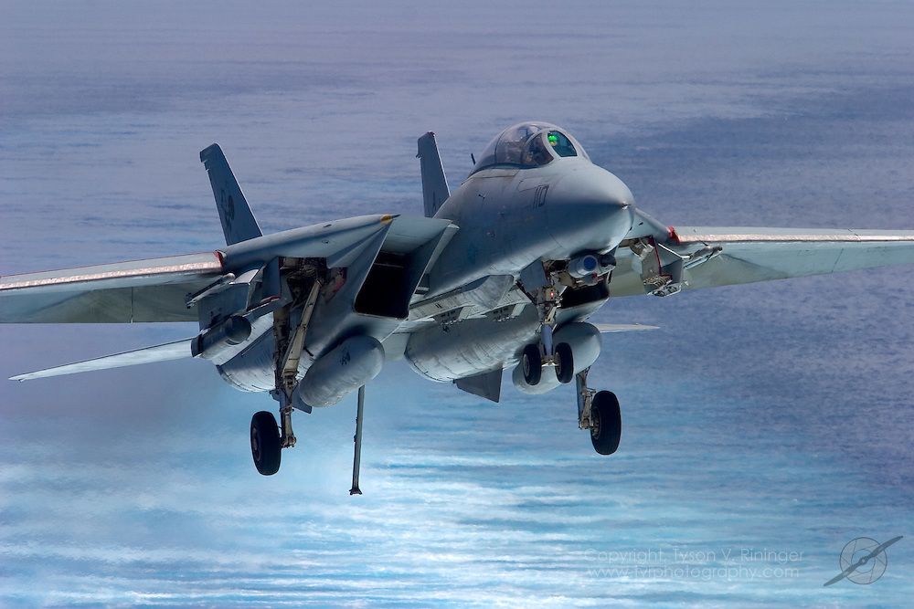 AJ110, an F-14 Tomcat from VF-31 'Tomcatters', is on approach for a trap aboard the deck of the USS Theodore Roosevelt CVN-71 during sea trials prior to their 2005 Mediterranean deployment. This would be the final cruise for the F-14 Tomcat and the last time it would ever see combat.