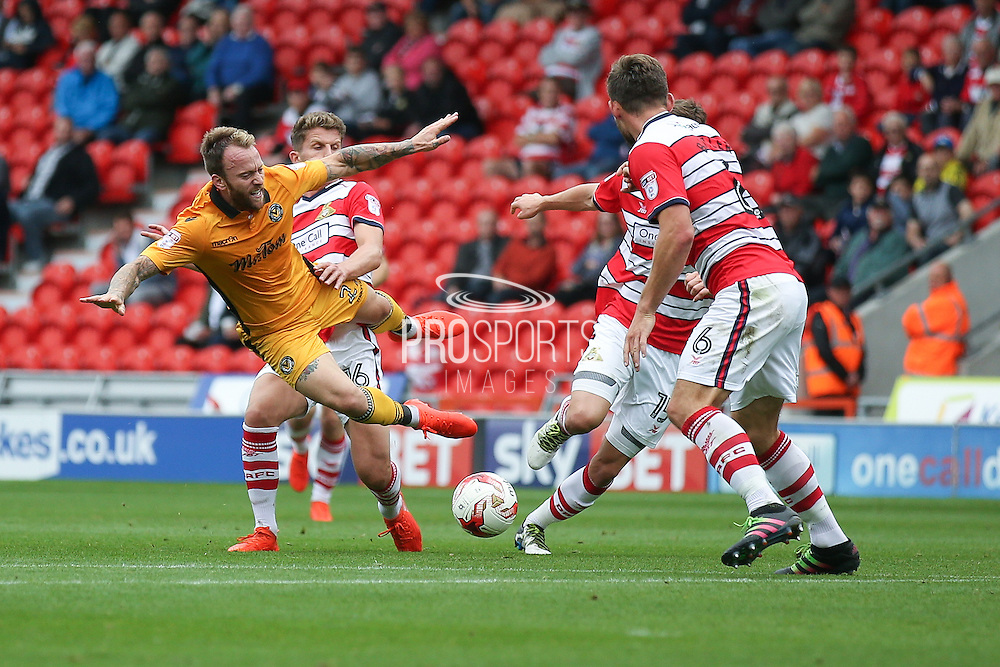 Newport County  midfielder Sean Rigg (27)  goes down under the challenge of Doncaster Rovers midfielder, on loan from Chelsea, Jordan Houghton (16)  during the EFL Sky Bet League 2 match between Doncaster Rovers and Newport County at the Keepmoat Stadium, Doncaster, England on 17 September 2016. Photo by Simon Davies.