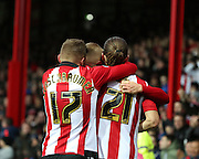Brentford striker Lasse Vibe celebrating scoring during the Sky Bet Championship match between Brentford and Milton Keynes Dons at Griffin Park, London, England on 5 December 2015. Photo by Matthew Redman.