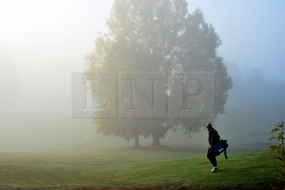 © Licensed to London News Pictures. 23/10/2016<br /> Foggy morning in Kent.<br /> Cray Valley Golf Club golfer in Orpington,Kent play golf in the autumn fog.<br /> <br /> Photo credit :Grant Falvey/LNP