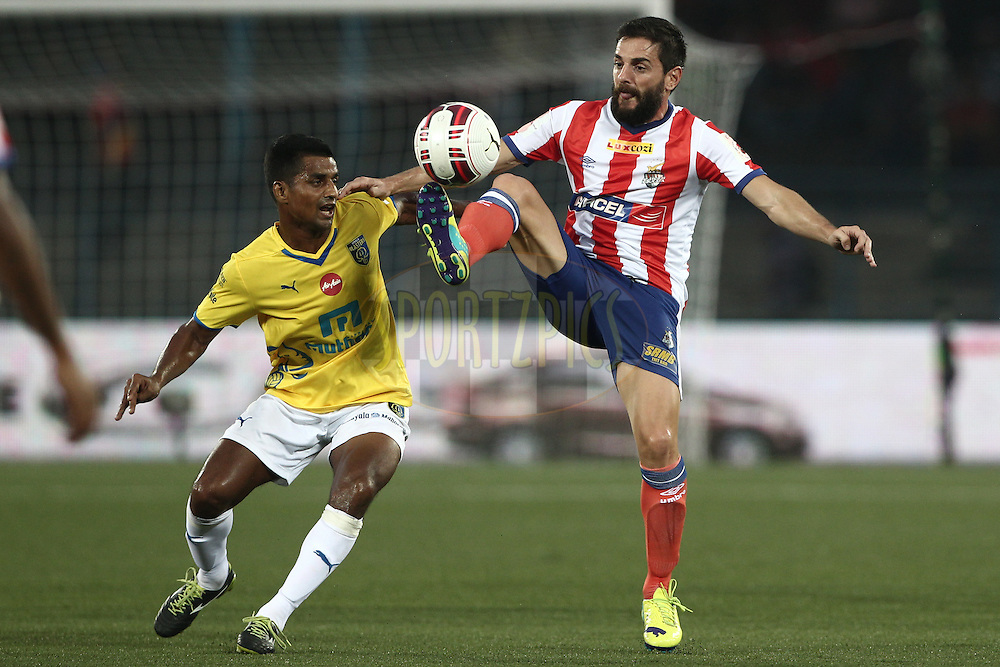 Joffre Mateu Gonzalez of Atletico de Kolkata and Mehtab Hossain of Kerala Blasters FC in action during match 13 of the Hero Indian Super League between Atl&eacute;tico de Kolkata and Kerala Blasters FC held at the Salt Lake Stadium in Kolkata, West Bengal, India on the 26th October 2014.<br /> <br /> Photo by:  Deepak Malik/ ISL/ SPORTZPICS